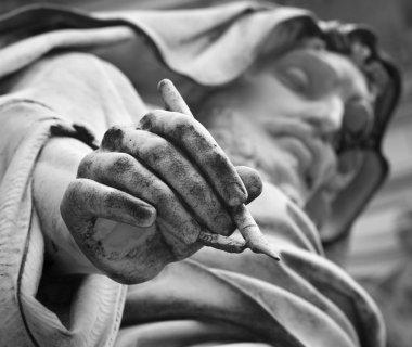 Rome - Detail of st. John the Evangelist statue