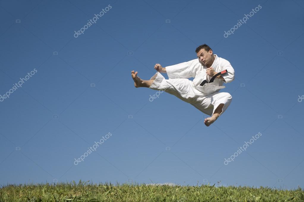 Karate kick of man