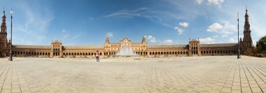 Panoramic photo of Plaza de Espana in the city Park Maria Luisa. Blue sky. The capital city Sevilla. Andalusia. Spain.