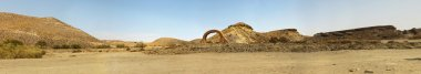 Panoramic photo of western landscape with stone arch. Fort Bravo. Texas Hollywood. Desierto de Tabernas, Almeria. Andalusia. Spain.