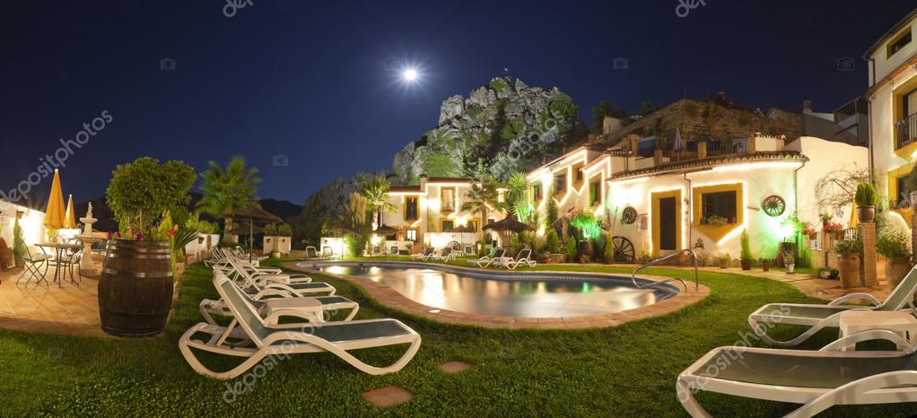Beautiful hotel in mountain village with swimming pool at night. Panoramic photo. Montejaque. Malaga. Andalusia. Spain.