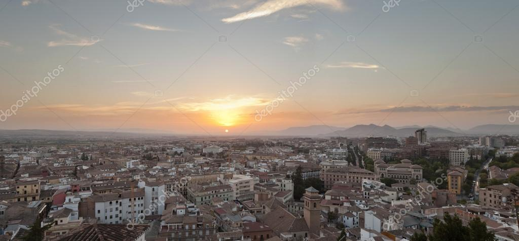 Beautiful panoramic photo overviewing the modern city of Granada at sunset. Blue cloudy sky. Andalusia. Spain.