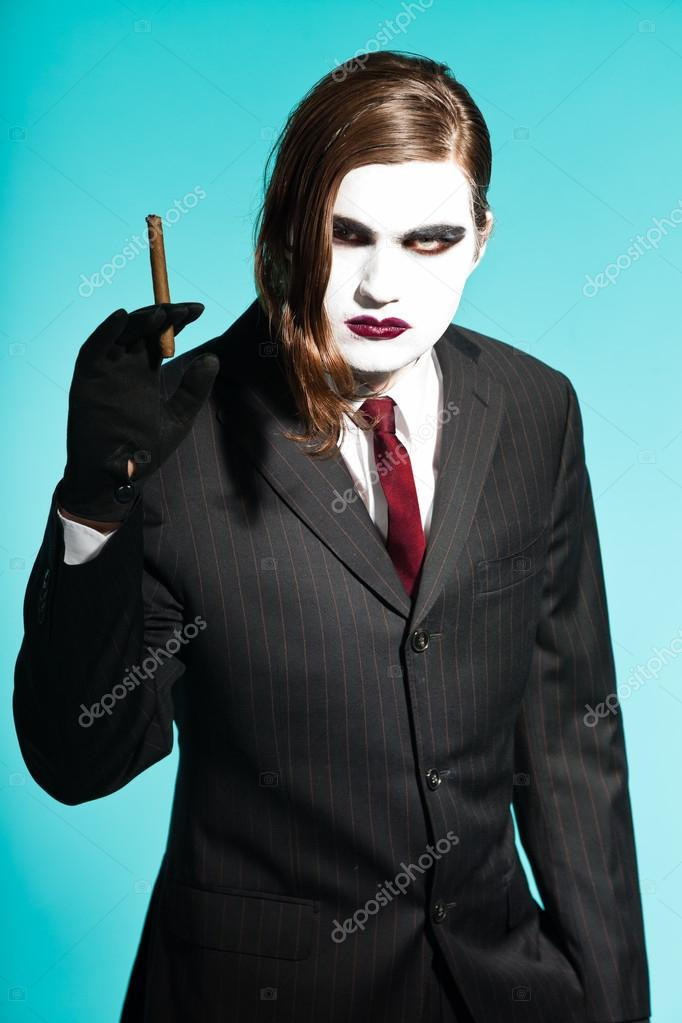 Gothic Vampire Looking Business Man Wearing Black Striped Suit And Dark Red Tie