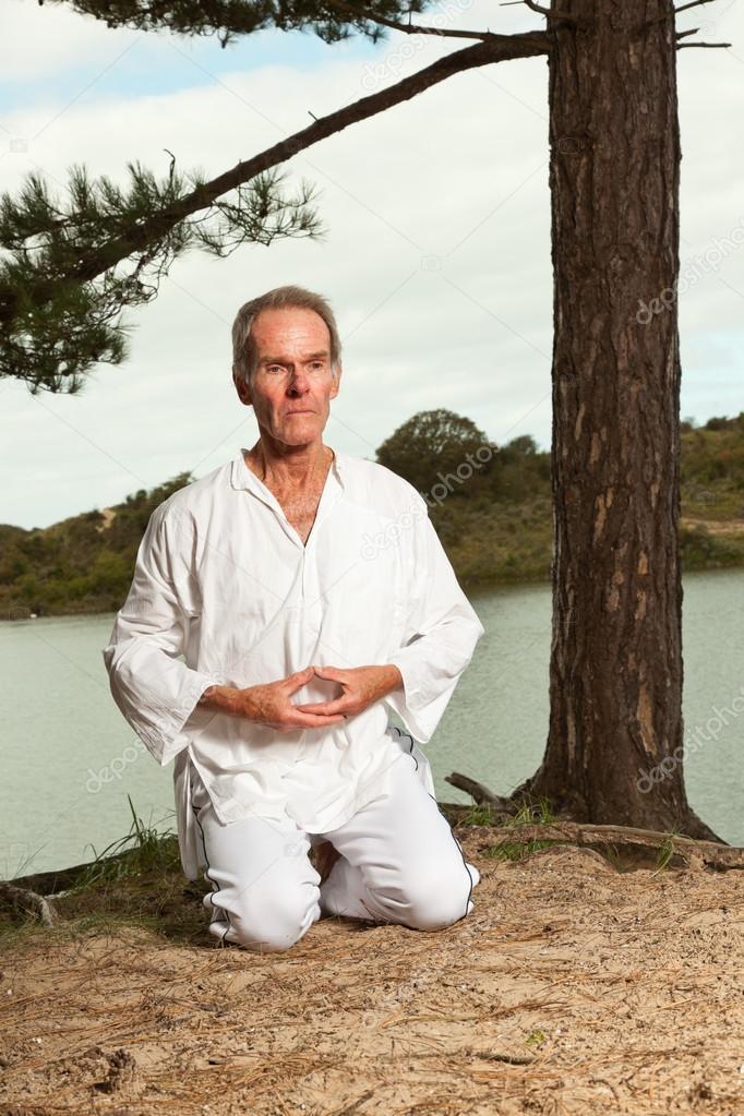Senior spiritual man dressed in white.