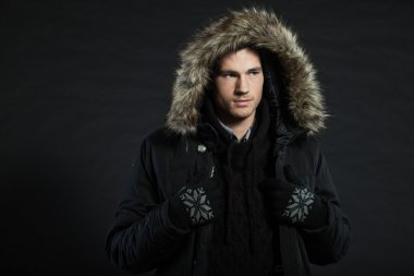 Handsome man dark winter fashion.