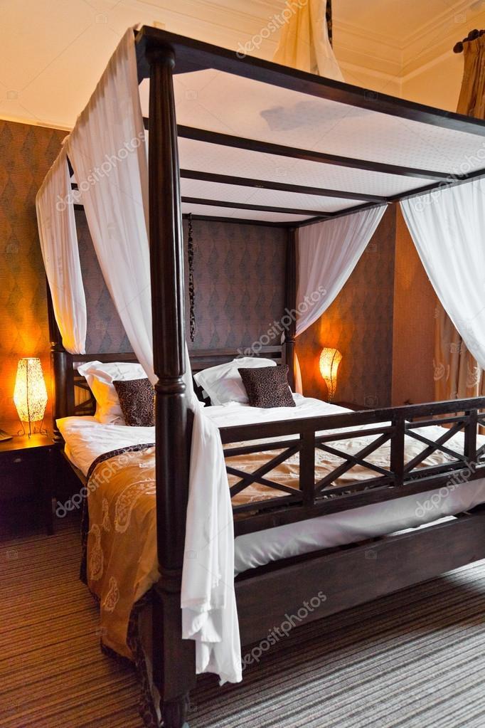 Afrikanischen Stil Schlafzimmer. — Stockfoto © ysbrand #18054169