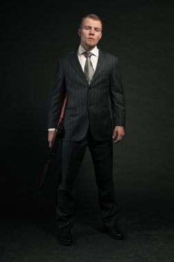 Mafia man with gun.