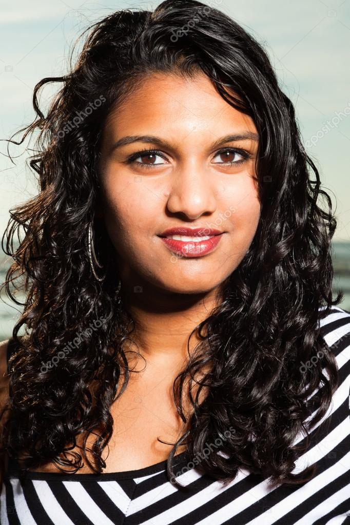 Pretty Indian Girl With Long Hair On The Beach In Summer Stock