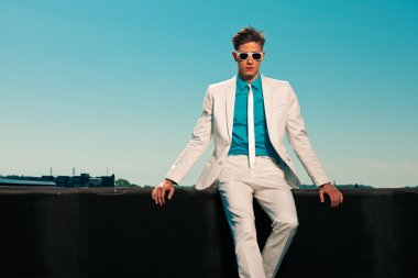Retro fifties summer fashion man with white suit and sunglasses.