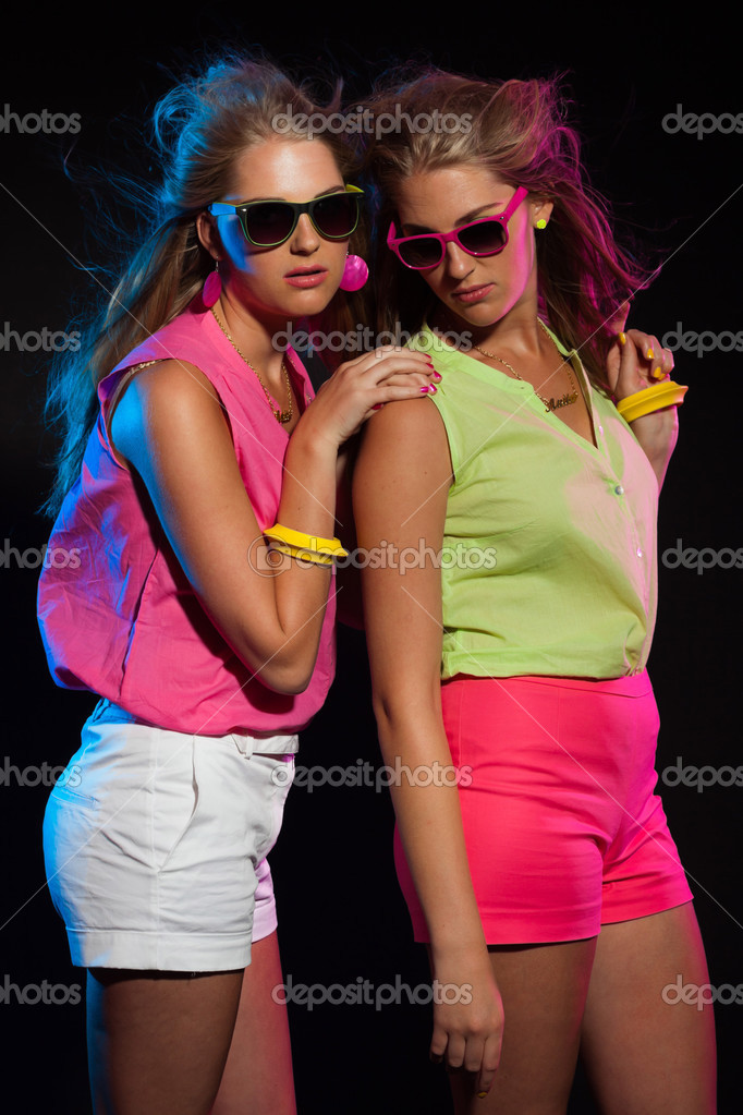 two sexy retro 80s fashion girls with long blonde hair and sungl stock photo ysbrand 28277419. Black Bedroom Furniture Sets. Home Design Ideas
