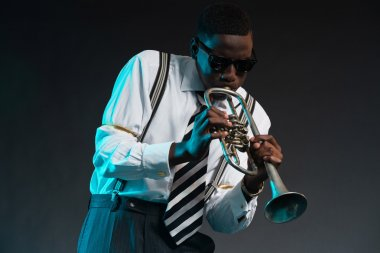 Retro african american jazz musician playing on his trumpet. Wea