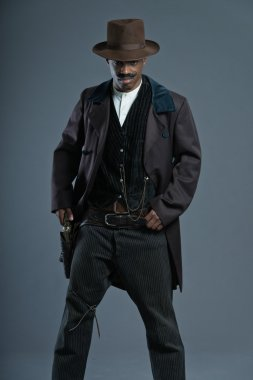 Retro Afro america western cowboy man with mustache. Taking his