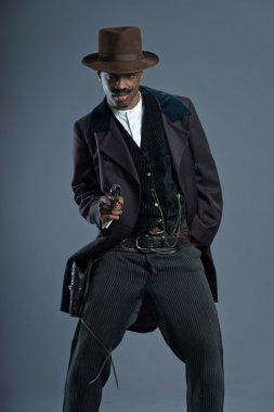 Shooting retro Afro america western cowboy man with mustache. We