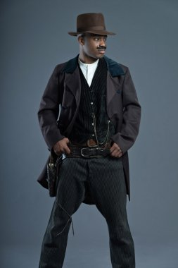 Retro Afro america western cowboy man with mustache. Wearing bro
