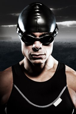Triathlon swimmer man with cap and glasses outdoor at rough sea