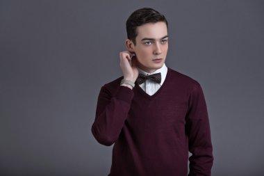 Retro fifties english style fashion young man. Wearing dark red