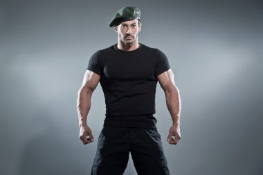 Commander muscled action hero man wearing black t-shirt and pant