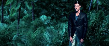 Asian business fashion man in jungle with green ferns and palm t
