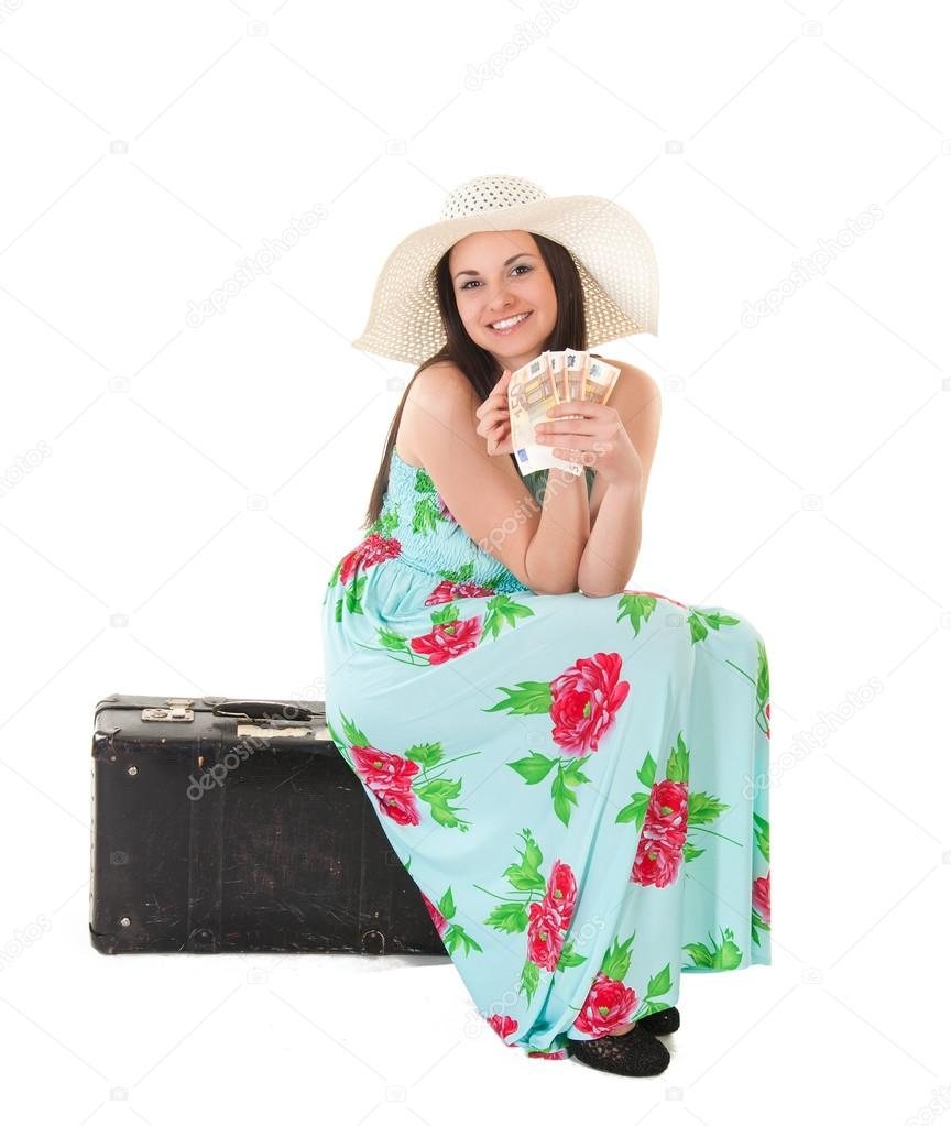 beautiful woman in summer dress with hat, case and money