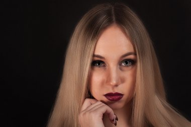 a Blonde gothic priestess in the dark.