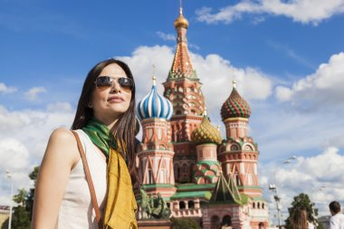 Tourist woman in front of saint basil cathetral in moscow