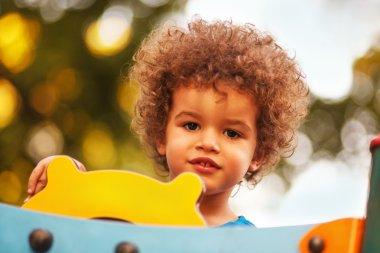 Cute mixed race boy in park