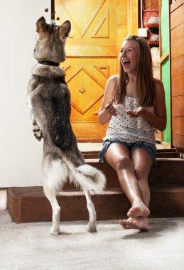 Teenage girl feeding dog