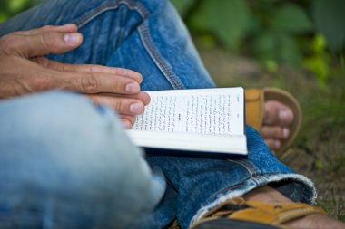 Young Man Ex-muslim Reading Bible Outside