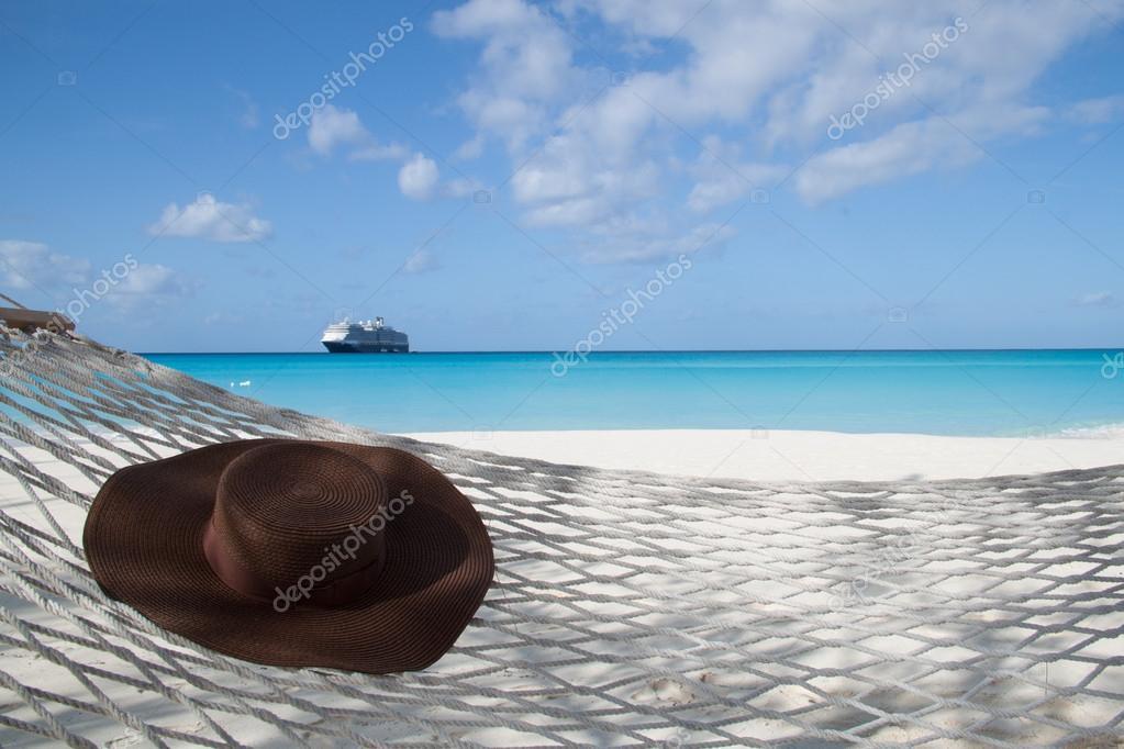 Hat on a hammock on the beach