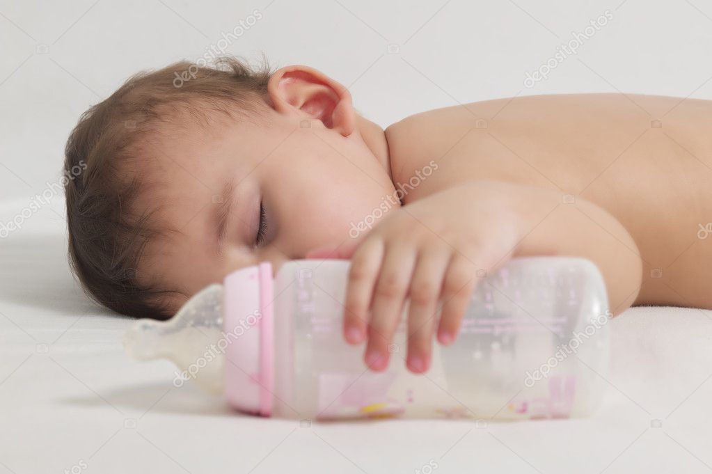 Baby sleeping after drinking here bottle
