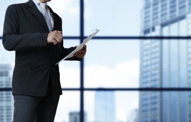 view of businessman reading documents in hand