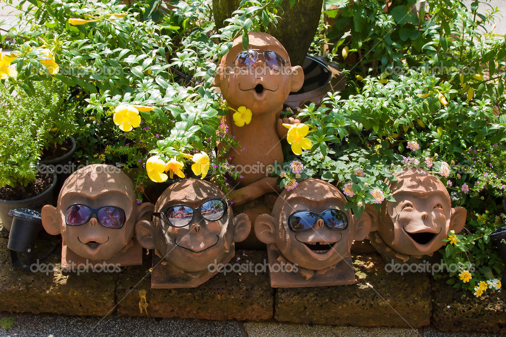 Sculpture of a monkey with sunglasses