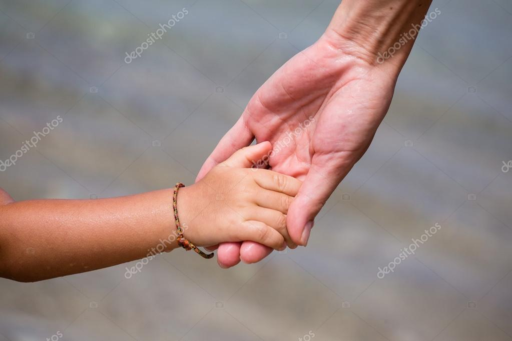 Hands of mother and child
