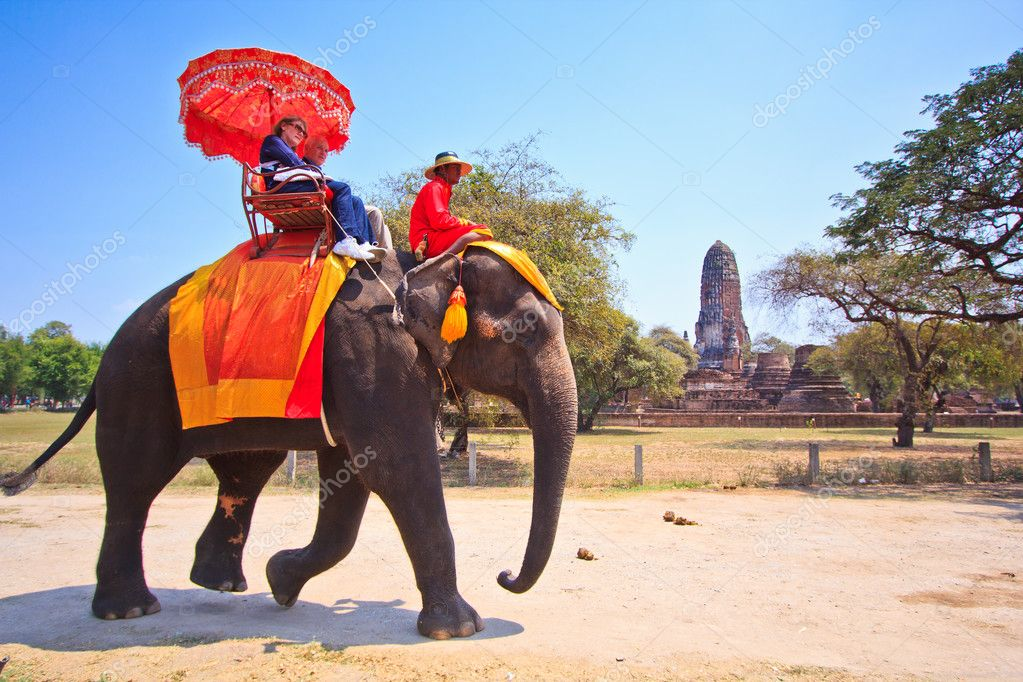AYUTTHAYA, THAILAND - MARCH 7: Tourists on an elephant ride tour of the ancient city on March 7, 2013 in Ayutthaya.