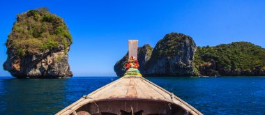 Tail boat at sea