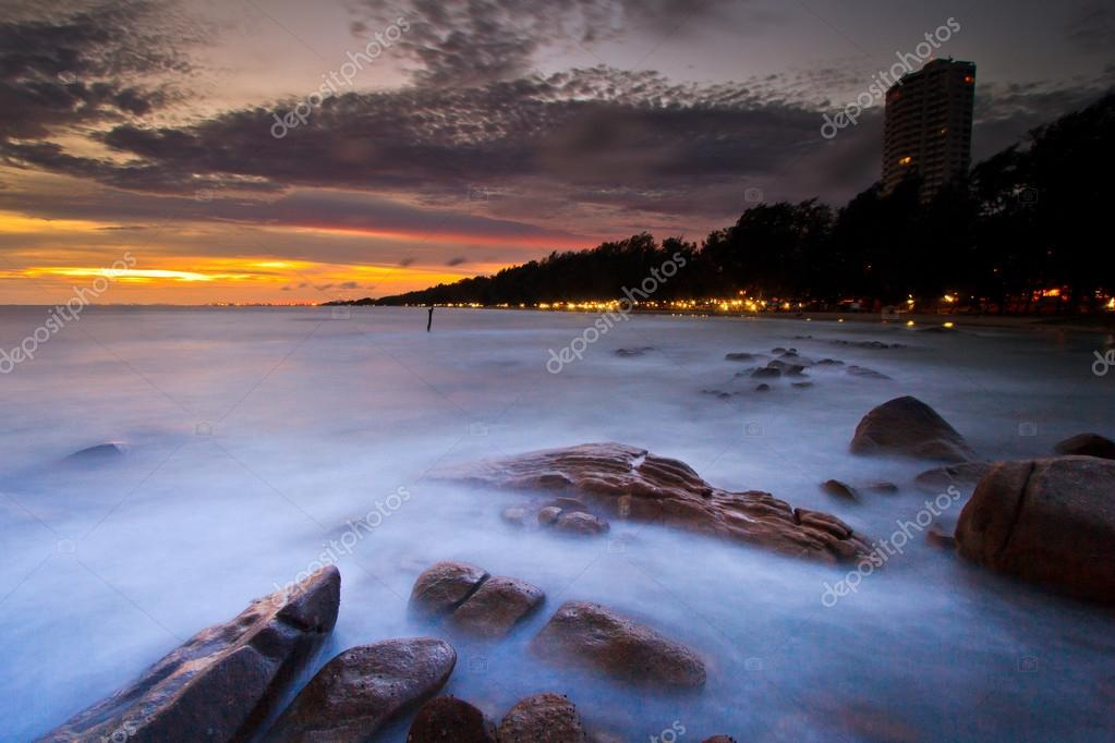 Sunset over sea rocks