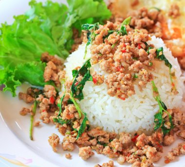 Fried pork with sweet basil.whit basil