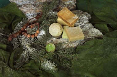 handmade soap on the bark and twigs of trees
