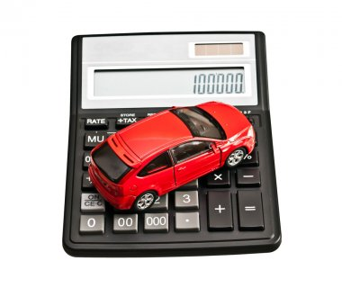 Toy car and calculator. Concept for buying, renting, insurance