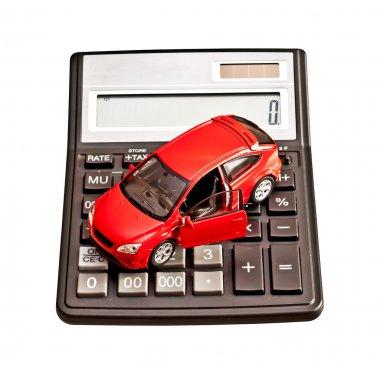 Toy car and calculator over white. Concept for buying, renting,