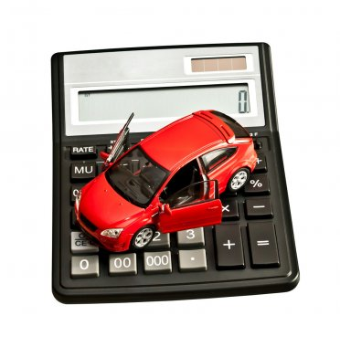 Toy car and calculator over white. Rent, buy, repair or insuranc