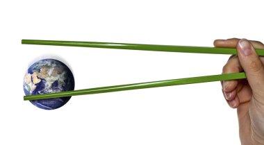 Lost blue planet earth between green chopsticks