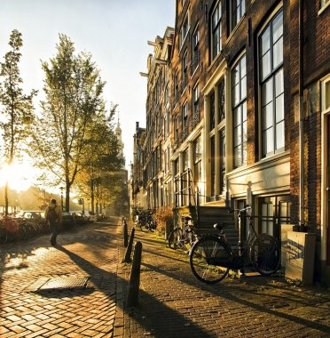 Wonderful and idyllic street scene at sunset in amsterdam.
