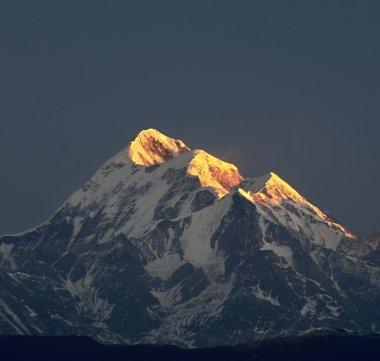 Illuminated mountain peak