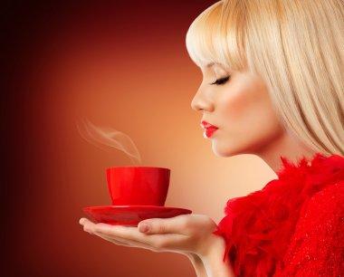 Beautiful blonde woman with coffee