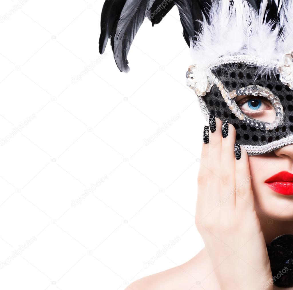 Beautiful girl in black carnival mask with manicure