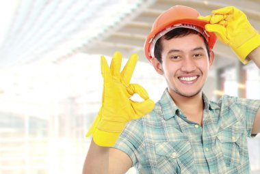 happy worker showing ok sign