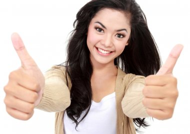 smiling girl shows two thumbs up