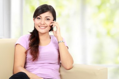 happy asian woman is calling