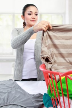 woman having laundry at home